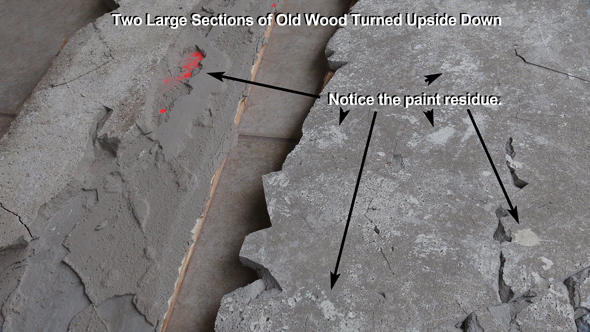 These two large sections of old wood were turned upside down to reveal construction dust and paint residue that prevented a solid bond of the floor patch to the concrete foundation.