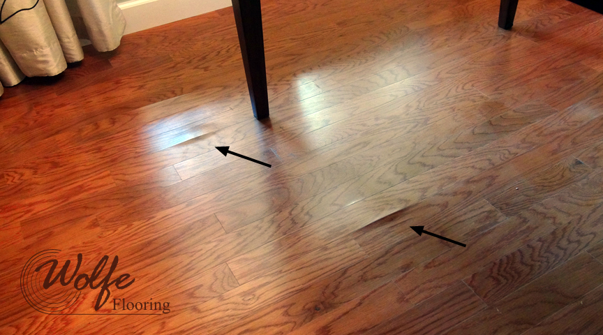 Two Joints Cupping to Create Evident Moisture Damage in the Dining Room