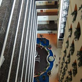 20-Story Open Atrium Hotel – Custom Carpet and Porcelain