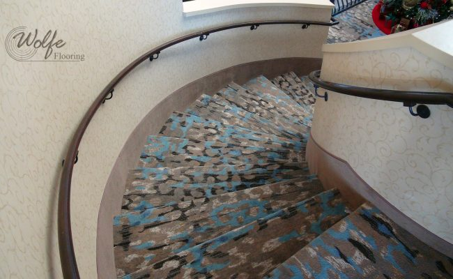 20-Story Open Atrium Hotel (10) – Grand Staircase – Spiral Stairs with Carpet Stringers