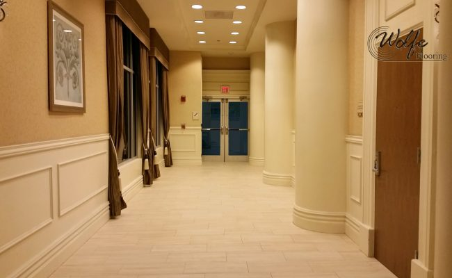 20-Story Open Atrium Hotel (23) – Napoli Mill Travertine Porcelain Tile – Skybridge Entrance